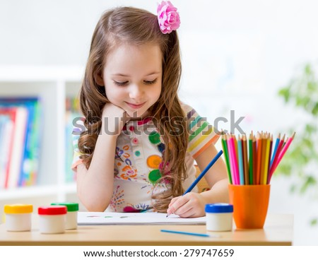 Cute little preschooler child drawing at home Royalty-Free Stock Photo #279747659