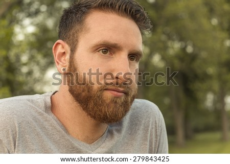 Portrait of bearded young man with gauged ears and stylish hair #279843425