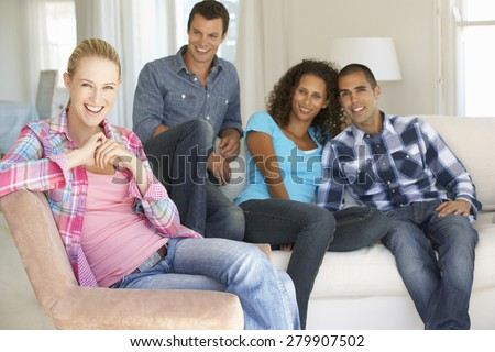 Group Of Friends Relaxing On Sofa At Home Together #279907502