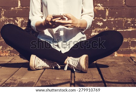Beautiful young hipster woman using smart phone Royalty-Free Stock Photo #279910769