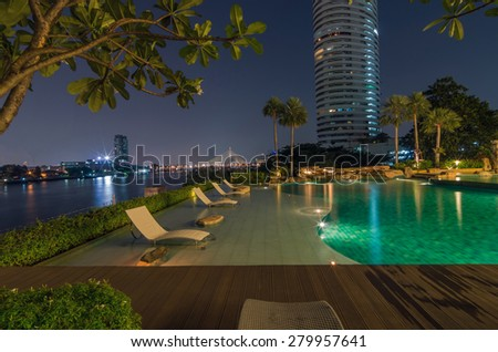 BANGKOK, THAILAND - APRIL 23 : Luxury Swimming pool of My resort as river condominium beside the chao phraya river on April 23, 2015 in Bangkok, Thailand #279957641