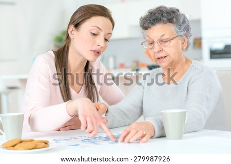 Old lady doing a jigsaw puzzle #279987926