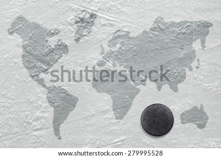 Hockey puck on the ice with the image of a world map
