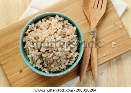 Organic Brown Rice in the bowl on the wooden table #280020284