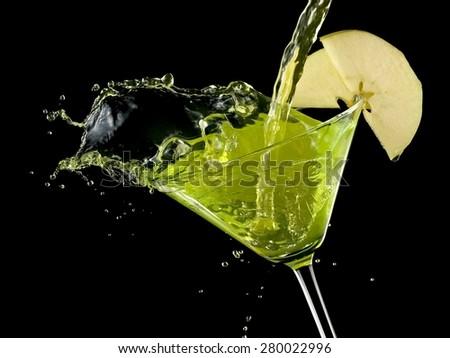 Appletini cocktail splash, close up #280022996