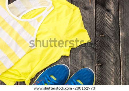 Running equipment for the woman on the old wooden background. Sport equipment #280162973