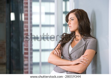 Business woman arms crossed in a modern office #28019344