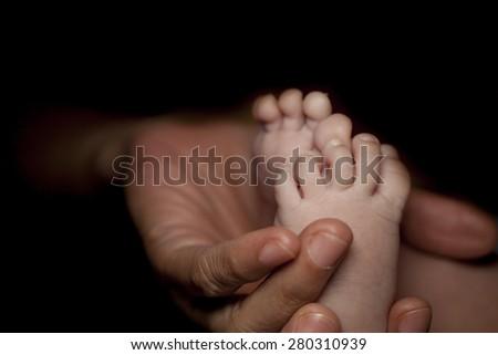Tiny foot of newborn. #280310939
