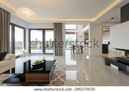 Photo of spacious expensive living room with shining marble floor #280370030