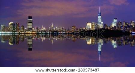 New York City at night panorama with urban architectures and reflections  #280573487