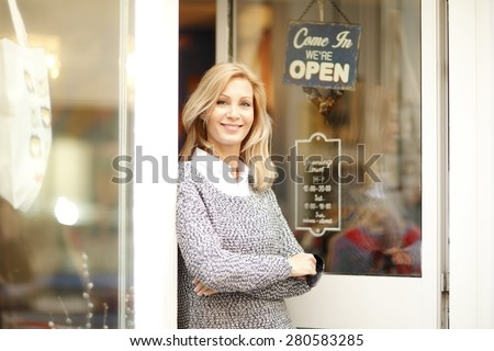 Portrait of designer woman standing in front of small vintage store. Small business. Royalty-Free Stock Photo #280583285