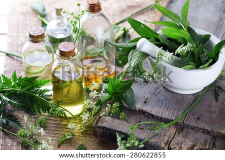 Organic essential aroma oil with mint  on aged wooden background. Selective focus.  Royalty-Free Stock Photo #280622855