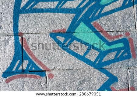 brick wall with fragment of graffiti  #280679051