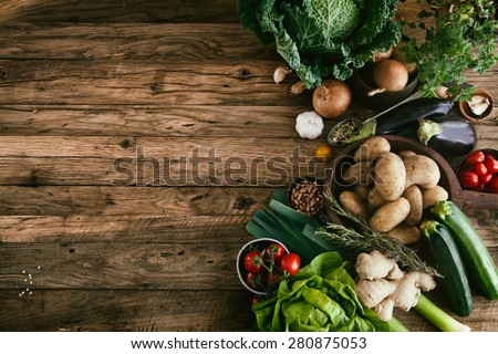 Vegetables on wood. Bio Healthy food, herbs and spices. Organic vegetables on wood Royalty-Free Stock Photo #280875053