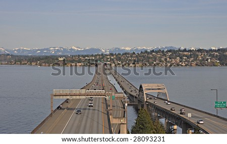 The I-90 floating bridge in Seattle. Mercer Island and the cascade mountains in the background. #28093231