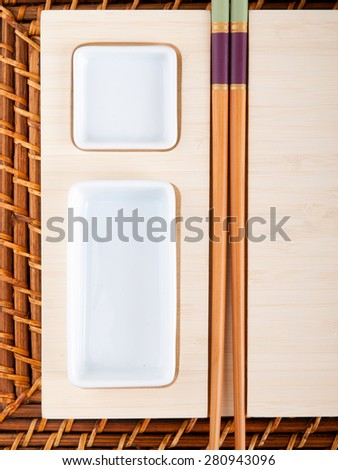 Sushi table with plates and sticks #280943096