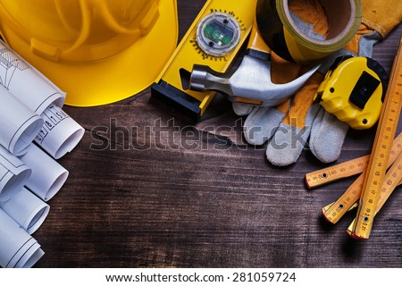 Construction drawings and set of building tools on vintage pine wood board maintenance concept  #281059724