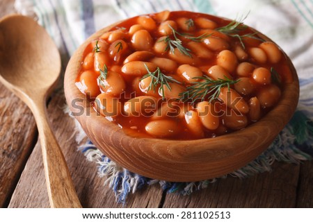 white beans in tomato sauce in a wooden bowl closeup. horizontal #281102513