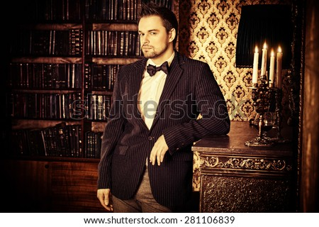 Handsome elegant young man in classic vintage apartments. Fashion. Luxury. #281106839