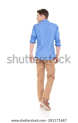 Back view of a young fashion man walking on isolated background looking to his side. #281171687