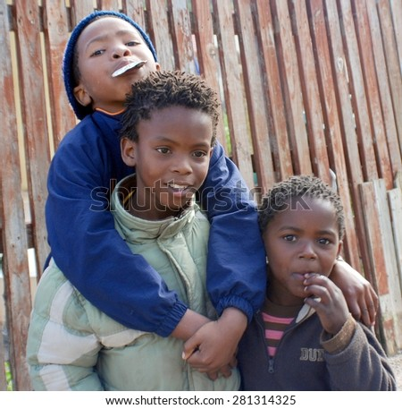 KHAYELITSHA, CAPE TOWN - MAY 22 : A unidentified group of young boys play in a street of Khayelitsha township, on May 22, 2007, Cape Town, South Africa #281314325
