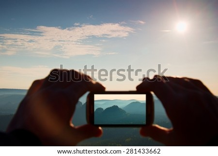 Smart phone mobile photography of sunny rocky mountains landscape
