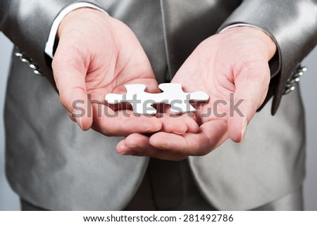 businessman show white jigsaw in hand, business strategy concept #281492786