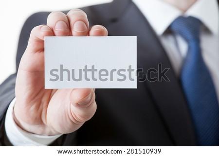 Unrecognizable businessman holding a visiting card, closeup shot #281510939