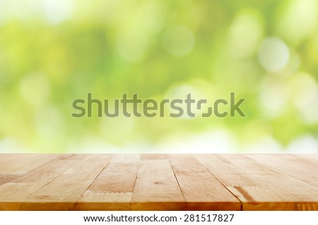Wood table top on green bokeh abstract background - can be used for montage or display your products #281517827