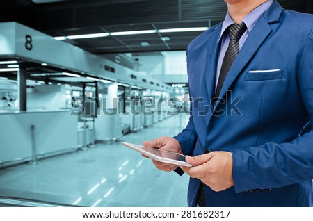 business man holding tablet in hand in blur background #281682317