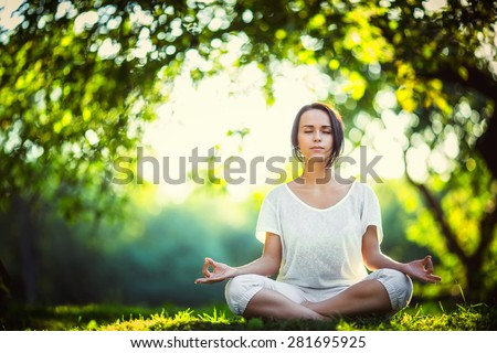 Young girl doing yoga in the park #281695925