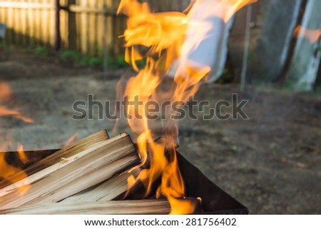 Fire with flames in a metal brazier for kebab #281756402