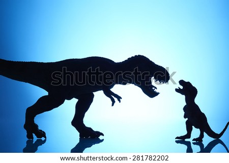 shooting dinosaur model on blue background #281782202