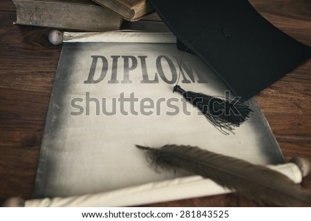 Mortar board and diploma, with text diplom and feather #281843525