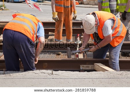 railway worker team in the street with a swinging a hammer #281859788