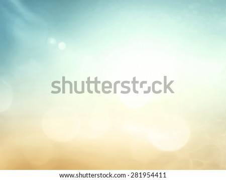 Summer holiday concept: Abstract blurred sun light beach with autumn sunset sky background