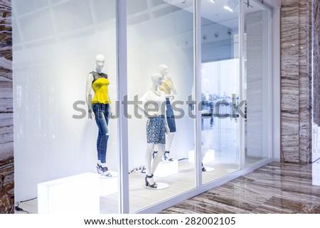 mannequins in fashion shop display window #282002105