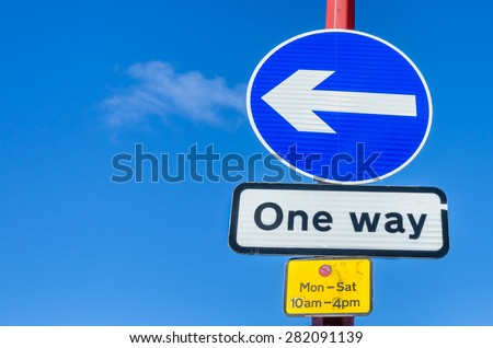 One Way Traffic Signs Against Blue Sky. Space for Copy.