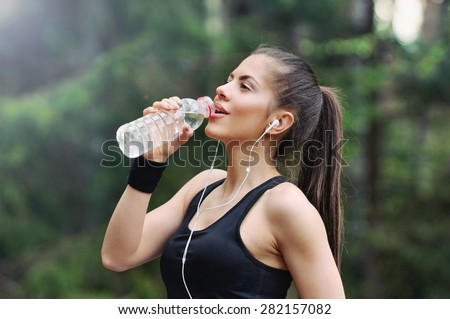 fitness sporty woman running early in the morning in forest area, healthy lifestyle concept Royalty-Free Stock Photo #282157082
