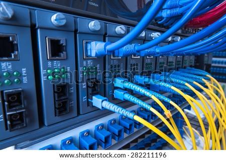 Fiber optic equipment in a data center Royalty-Free Stock Photo #282211196