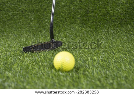 Golf club and ball in artificial Turf #282383258