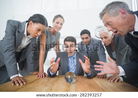 group of business man predict the future with a crystal ball