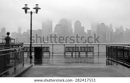 Black and white photo of New York City skyline on a rainy day