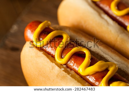 Barbecue Grilled Hot Dog with Yellow Mustard Royalty-Free Stock Photo #282467483