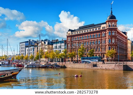 Scenic summer view of the Old Port pier architecture with ships, yachts and other boats in the Old Town of Helsinki, Finland #282573278