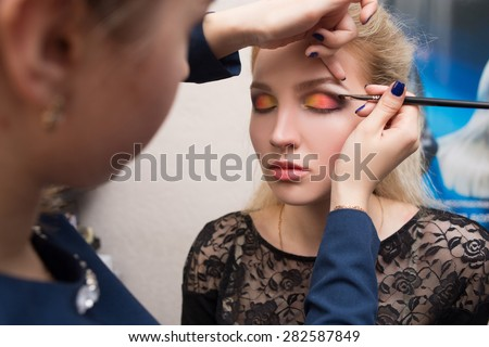 girl applied make-up on her eyes #282587849