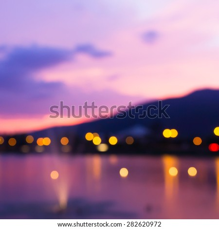 Colorful bokeh of city from the sea in night time #282620972