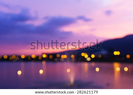 Colorful bokeh of city from the sea in night time #282621179