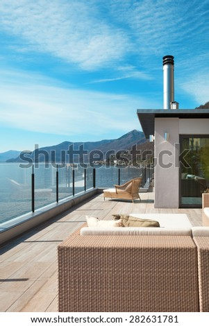 modern architecture, beautiful lake view from the terrace of a penthouse #282631781
