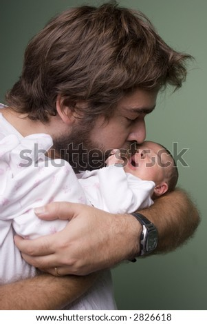 Young father kissing his newborn baby #2826618
